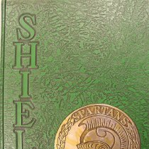 Image of Shield, 1964 - This item is an Oak Lawn Community High School yearbook from 1964.  The cover is green and features a gold emblem with a Spartan's head.