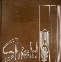 Image of Shield, 1965 - This item is an Oak Lawn Community High School yearbook from 1965.  It has a brown cover with letters and images outlined in white.