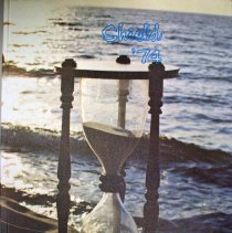 Image of Shield, 1974 - This item is an Oak Lawn Community High School yearbook from 1974.  The cover features a picture of a body of water and an hourglass.