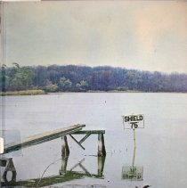 Image of Shield, 1975 - This item is an Oak Lawn Community High School yearbook from 1975.  The cover features an image of a lake surrounded by trees.