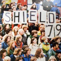 "Image of Shield, 1979 - This item is an Oak Lawn Community High School yearbook from 1979.  The cover features a crowd of students, with several holding up letters and numbers to create ""SHIELD"" ""'79""."