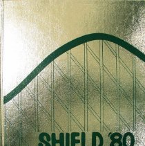 Image of Shield, 1980 - This item is an Oak Lawn Community High School yearbook from 1980.  It features a silver cover with a roller coaster design winding around the book.