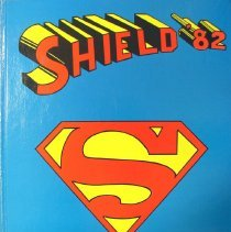 "Image of Shield, 1982 - This item is an Oak Lawn Community High School yearbook from 1982.  It features a blue cover with red and yellow lettering and the ""Superman"" shield."