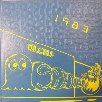 "Image of Shield, 1983 - This item is an Oak Lawn Community High School yearbook from 1983. The cover is blue and yellow in color and features several characters from the game ""Pac Man""."