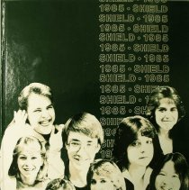 Image of Shield, 1985 - This item is an Oak Lawn Community High School yearbook from 1985.  The cover is dark green in color and features photographs of students.