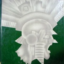 Image of Shield, 1986 - This item is an Oak Lawn Community High School yearbook from 1986.  The cover is green and silver with an image of a Spartan warrior's profile.