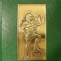 Image of Shield, 1987 - This item is an Oak Lawn Community High School yearbook from 1987.  The cover is green in color with a gold image of a Spartan soldier.