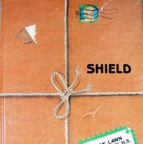 Image of Shield, 1989 - This item is an Oak Lawn Community High School yearbook from 1989.  The cover is orange in color and has the appearance of a package with string tied around it.