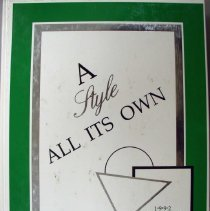 Image of Shield, 1992 - This item is an Oak Lawn Community High School yearbook from 1992.  The cover is green and white in color and features three geometric shapes in the bottom right corner.