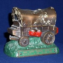 Image of Oak Lawn Federal Savings Toy Bank - This item is a toy bank produced by the Oak Lawn Federal Savings Bank as a promotion for Round-Up Days.  It is red, green, and bronze in color and there is a coin slot on the bottom.