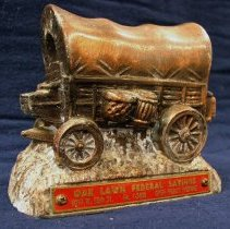 Image of Oak Lawn Federal Savings Toy Bank - This item is a toy bank produced by the Oak Lawn Federal Savings Bank as a promotion for Round-Up Days.  It is red and bronze in color and there is a coin slot on the bottom.