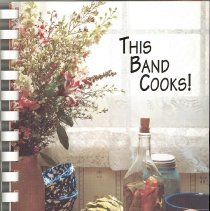 Image of This Band Cooks! - This item is a cookbook compiled by the Oak Lawn Community High School Band Parents Association in 2002.  The cover has an image of a table with food on it.