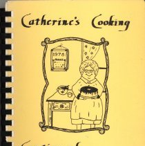 Image of Catherine's Cooking Continued - This item is a cookbook compiled by St. Catherine of Alexandria School Board in 1978.  The cover is yellow with the image of a woman in a kitchen.