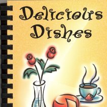 Image of Delicious Dishes - This item is a cookbook compiled by family and friends of the Park Lawn Association in 1999.  The cover is yellow with images of kitchen implements.