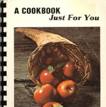 Image of A Cookbook Just For You - This item is a cookbook compiled by the Business and Professional Women's Club of Oak Lawn in 1981.  The front has an image of a cornucopia with apples.