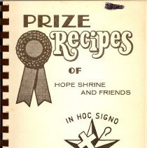 Image of Prize Recipes of Hope Shrine and Friends - This item is a cookbook compiled by the Hope Shrine and Friends of Oak Lawn, a women's organization associated with Freemasonry.  The cover is brown and has several symbols.