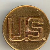 Image of United States Army Uniform Pin - This item is a United States Army uniform pin.  It is bronze in color and was owned by Harold Lawson, a former area resident who served in the armed forces.