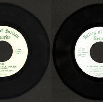 Image of Emerald Island Polka/A Blade of Grass - This item is a 45 RPM record featuring the Emerald Island Polka by Lee Edwards.  It was produced in 1983 by a Division of Lee Edwards Productions Inc. on Valley of Jordan Records.  This company was located in Oak Lawn.