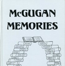 Image of McGugan Yearbook, 1997 - This item is the 1996 - 1997 McGugan Junior High School Yearbook.  The cover is silver with an image of a stack of books.