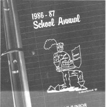 Image of Simmons School Yearbook, 1987 - This item is the 1986 - 1987 yearbook from Simmons School.  The cover has an image of a knight kneeling on the page of a binder.