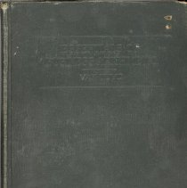 Image of Essentials of Business Arithmetic - This item is a Essentials of Business Arithmetic book used by early Oak Lawn teacher Wiley Simmons. The cover is dark green with dark lettering. After coming to Oak Lawn, Simmons would spend many years at Cook School, District 122 (later Simmons School), and elsewhere.
