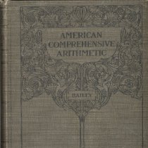 Image of American Comprehensive Arithmetic - This item is The American Comprehensive Arithmetic textbook used by early Oak Lawn teacher Wiley Simmons.  The cover is green with black writing.  After coming to Oak Lawn, Simmons would spend many years at Cook School, District 122 (later Simmons School), and elsewhere.
