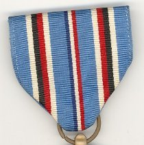 "Image of World War II ""American"" Campaign Medal - This item is an American Campaign Medal awarded to Oak Lawn resident Cathel Munro for his service in World War II.  There is an image of an eagle as well as a submarine, boat, and airplane.  Also included is an individual campaign medal ribbon.  Munro served with the 9th Infantry in the European theatre of war."