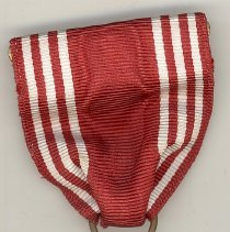 "Image of World War II ""Good Conduct"" Medal - This item is a Good Conduct Medal awarded to Oak Lawn resident Cathel Munro for his service in World War II.  There is an image of an eagle as well as a star.  Also included is an individual Good Conduct Ribbon.  Munro served with the 9th Infantry in the European theatre of war."