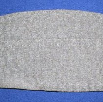 Image of Harold Lawson WWII Army Uniform Cap - This item is a United States Army uniform cap from World War II.  It is olive green with no identifiable markings.  The cap was owned by Harold Lawson, a former area resident who served in the armed forces.