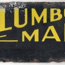 Image of Columbus Manor License Plate - This item is a Columbus Manor license plate used during the 1930s or 1940s. The front is black with yellow lettering and there is some rust damage.  At the time when this plate was used, Columbus Manor was an unincorporated community.