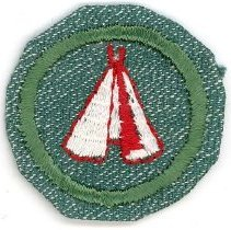 Image of Girl Scout Pioneer Merit Badge - This item is a Girl Scout Pioneer merit badge owned by local resident Marilyn (Drozdz) Brand.  It is green in color with a tepee near its center.