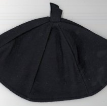 Image of St. Gerald Uniform Beanie Cap - This item is a beanie cap worn as part of the St. Gerald uniform during the 1950s.  It is dark blue in color on both the inside and the outside.  The item was owned by local resident Marilyn Brand.