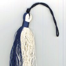 Image of St. Gerald Graduation Tassel - This item is a St. Gerald graduation tassel from 1956.  It is white and dark blue in color and was owned by local resident Marilyn Brand.