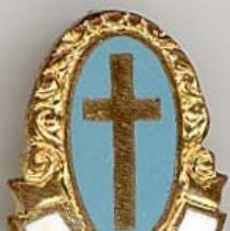 Image of St. Gerald Music Pin - This item is a St. Gerald School music pin from the 1950s.  It is blue, white, and gold in color. The pin was owned by local resident Marilyn Brand.