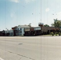 Image of 95th Street Near Minnick Avenue - Photograph of the south side of 95th Street near Minnick Avenue.  Businesses such as George Vlasis Realtors are visible, along with the Harker House and Hoffman House.
