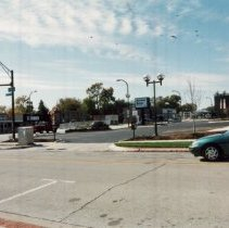 Image of 95th Street Near 54th Avenue - Photograph of the northwest corner of 95th Street and 54th Avenue.  Businesses such as Archer Bank, T.G.I. Friday's and the Lang Ice House are visible.