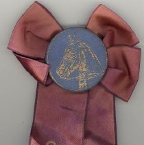 Image of Oak Lawn Round-Up Ribbon, 1956 - This item is a purple ribbon given out during the 1956 Oak Lawn Round-Up.  There is an image of a horse in the ribbon's center and text on the lower half.