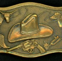 Image of Oak Lawn Round-Up Belt Buckle - This item is a belt buckle used during the Oak Lawn Round-Up Days.  The buckle is gold in color and has an image of a cowboy hat near its center.
