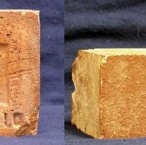 Image of Brick from Cook Avenue School - This item is a brick from the former Cook Avenue School. It was manufactured in Nelsonville, Ohio, and is red in color. Built in 1906, Cook School would see several renovations during its life and was used for education into the 1960s. The building was torn down in late 2003.