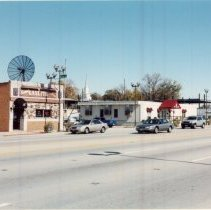 Image of 95th Street Looking North Near Cook Avenue - Photograph of 95th Street looking north near Tulley Avenue.  Krauss' Gaslite Lounge, Pilgrim Faith Church and the Oak Lawn Hilton are all visible.