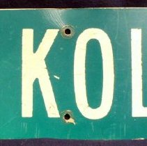 Image of Ernie Kolb Parking Sign - This item is a metal parking sign used by former Village Mayor Ernie F. Kolb.  It is green in color with white lettering.
