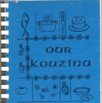 Image of Our Kouzina - This item is a cookbook compiled by the Ladies Auxiliary of St. Nicholas Church.  The cover is blue with black lettering and features several cooking related images.