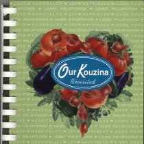 Image of Our Kouzina Revisited - This item is a cookbook compiled by the Ladies Philoptochos Society of St. Nicholas Church.  The cover is green with a blue logo near the center.
