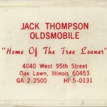 "Image of Jack Thompson Oldsmobile First Aid Kit - This item is a first aid kit given out by Jack Thompson Oldsmobile located at 4040 West 95th Street in Oak Lawn.  The box is white and red in color and features the slogan ""Home of the Free Loaner""."