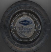 Image of Goodyear Service Store Ashtray - This item is an ashtray from the Goodyear Tire Service Store located at 4810 West 95th Street in Oak Lawn.  There is a glass ashtray in the center and it is surrounded by a plastic tire.