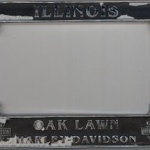Image of Harley-Davidson License Plate Cover - This item is an license plate holder from the Oak Lawn Harley-Davidson dealership.  The item is black and silver in color.
