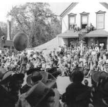 Image of Oak Lawn Round-Up Days Parade - This is a photograph of the Oak Lawn Round-Up Days parade on 95th Street near Cook Avenue.  Structures such as the Hilgendorf House (right) can be seen in the background.