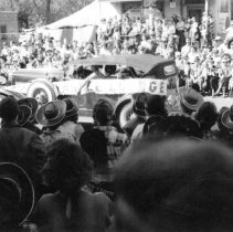 Image of Oak Lawn Round-Up Days Parade - This is a photograph of the Oak Lawn Round-Up Days parade on 95th Street near Cook Avenue.  Structures such as the Hilgendorf House (center) can be seen in the background.