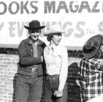 Image of Oak Lawn Round-Up Days  - This is a photograph of the Oak Lawn Round-Up Days celebration.  There are several people pictured in Western style clothing.