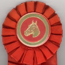 Image of Oak Lawn Round-Up Ribbon, 1952 - This item is a red ribbon given out during the 1952 Oak Lawn Round-Up.  There is an image of a horse in the ribbon's center and text on the lower half.